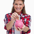 portrait of a woman putting a note a piggy bank against a white background stock photo © wavebreak_media