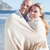 Happy couple wrapped up in blanket on the beach stock photo © wavebreak_media