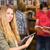főiskola · diákok · könyvtár · csoport · lány · könyvek - stock fotó © wavebreak_media