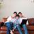 szülők · gyerek · laptopot · használ · remek · copy · space · kanapé - stock fotó © wavebreak_media