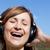 gioioso · donna · ascolto · musica · outdoor · cielo · blu - foto d'archivio © wavebreak_media