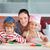 family in the kitchen smiling at the camera stock photo © wavebreak_media