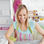 Cheerful woman baking together with her friend at home in the kitchen stock photo © wavebreak_media