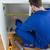 Portrait of a repair man measuring something in a kitchen stock photo © wavebreak_media