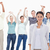 Close-up of a woman with people raising their arms in background stock photo © wavebreak_media