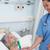 enfermeira · tocante · mão · paciente · hospital · homem - foto stock © wavebreak_media
