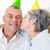 casal · sala · de · estar · beijando · sorridente · mulher · homem - foto stock © wavebreak_media