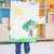 Cute little boy showing his painting in classroom stock photo © wavebreak_media