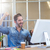 casual businessman cheering in front of his computer stock photo © wavebreak_media