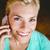 sorridente · jovem · mulher · atraente · telefone · móvel · café · em · pé - foto stock © wavebreak_media
