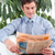Attractive businessman reading a newspaper on a sofa stock photo © wavebreak_media