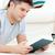 jonge · man · lezing · boek · vloer · woonkamer · man - stockfoto © wavebreak_media