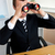 Businessman using binoculars in office stock photo © wavebreak_media