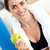 Radiant woman eating an apple on the sofa after working out in the living-room at home stock photo © wavebreak_media