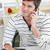 delighted man talking on phone using his laptop in the kitchen at home stock photo © wavebreak_media