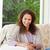 glimlachende · vrouw · vergadering · sofa · gelukkig · ontspannen · portret - stockfoto © wavebreak_media