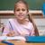 glimlachend · schoolmeisje · schrijven · klas · glimlach · wereldbol - stockfoto © wavebreak_media