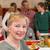 sorridere · donna · matura · posa · famiglia · casa · di · famiglia · soggiorno - foto d'archivio © wavebreak_media
