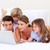 Merry family buying online lying down on bed stock photo © wavebreak_media