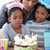 cute little girl and her family celebrating her birthday stock photo © wavebreak_media