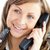 attractive businesswoman talking on phone holding glasses against white background stock photo © wavebreak_media