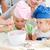 dois · crianças · mãe · preparação · bolinhos · juntos - foto stock © wavebreak_media
