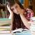 lehangolt · diák · könyvek · néz · kamera · nő - stock fotó © wavebreak_media