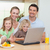 smiling family using the internet together in the kitchen stock photo © wavebreak_media