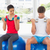 Couple lifting dumbbells while on fitness balls in gym stock photo © wavebreak_media