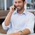 happy businessman talking on phone using his laptop stock photo © wavebreak_media