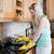 jonge · vrouw · schoonmaken · keuken · home · hand · vrouwen - stockfoto © wavebreak_media