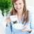 bright businesswoman holding a cup stock photo © wavebreak_media