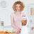 Good looking blonde woman using a mixer in the kitchen in her appartment stock photo © wavebreak_media