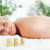 blonde woman lying on massage lounger in a wellness center stock photo © wavebreak_media