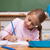 gelukkig · schoolmeisje · schrijven · klas · glimlach · wereldbol - stockfoto © wavebreak_media