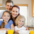 family together with breakfast behind the kitchen counter stock photo © wavebreak_media