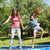 happy girl and mother jumping high on trampoline in park stock photo © wavebreak_media