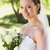 young bride holding bouquet in garden stock photo © wavebreak_media