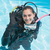 smiling woman on scuba training in swimming pool making ok sign stock photo © wavebreak_media