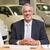笑みを浮かべて · ビジネスマン · 座って · デスク · 新しい車 · ショールーム - ストックフォト © wavebreak_media