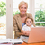 smiling of pretty blonde woman with his son using laptop stock photo © wavebreak_media