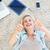 портрет · улыбающаяся · женщина · ноутбук · гостиной · компьютер · девушки - Сток-фото © wavebreak_media