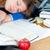 mulher · jovem · adormecido · secretária · lição · de · casa · livro · maçã - foto stock © wavebreak_media