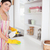 beautiful woman cleaning a cupboard in the kitchen stock photo © wavebreak_media
