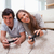 young couple playing video games on the floor stock photo © wavebreak_media