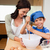mother and son having fun preparing a cake together stock photo © wavebreak_media