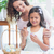happy mother and daughter painting easter eggs stock photo © wavebreak_media