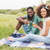young couple on a picnic drinking wine stock photo © wavebreak_media