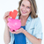 smiling woman holding piggy bank and red heart stock photo © wavebreak_media