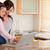 kız · anne · dizüstü · bilgisayar · kullanıyorsanız · mutfak · Internet · dizüstü · bilgisayar - stok fotoğraf © wavebreak_media
